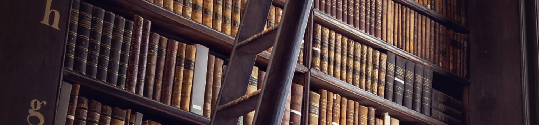 Stacks of law books header background